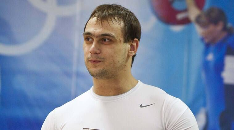 is the men's 94kg champion in weight lifting. (Source: Reuters)