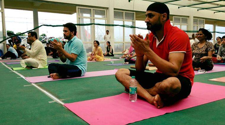 International Yoga Day, International Yoga Day Anurag Thakur, International Yoga Day photos, International Yoga Day Harbhajan Singh, International Yoga Day picture gallery, sports news, sports, cricket news, Cricket