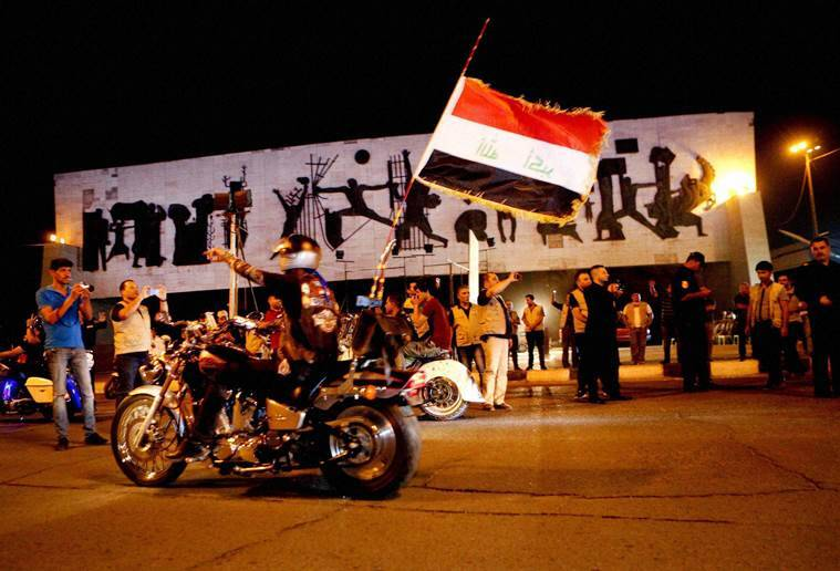 Baghdad : In this Saturday, June 18, 2016 photo, People take part in a celebration after Iraqi special forces entered the center of Fallujah city early Friday after fighting Islamic State militants, at Tahrir Square in Baghdad, Iraq. AP/PTI(AP6_19_2016_000100A)