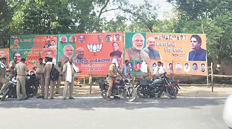 A poster of Modi, Shah and Varun Gandhi in Allahabad Saturday, a day before the BJP national executive meet