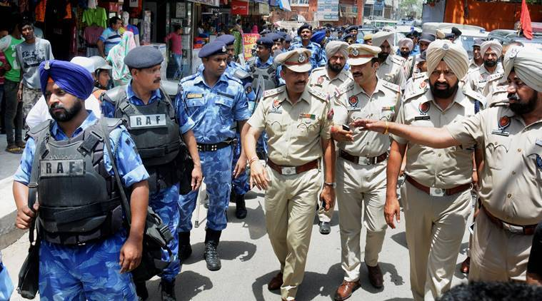Rapid Action Force (RAF) personnel take out flag march to instill a sense of security and safety among the residents of Amritsar ahead of the Operation Blue Star anniversary (source: PTI)