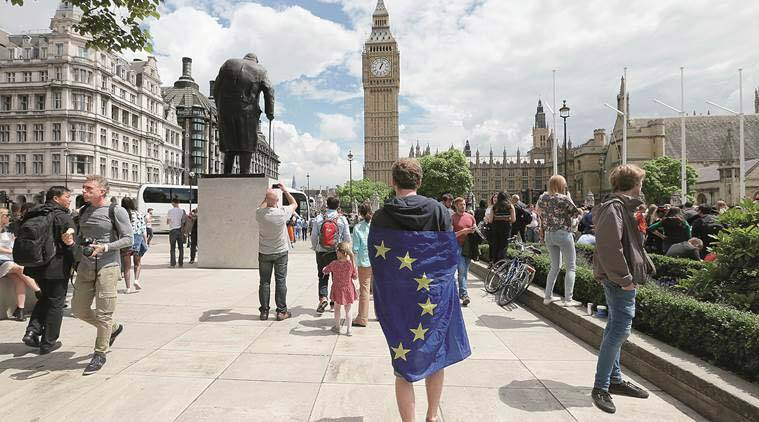 A protester wrapped in the European Union flag in London on Saturday. AP