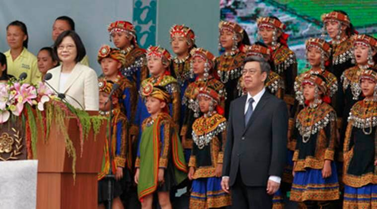 In this Friday, May 20, 2016, photo, Taiwan's President Tsai Ing-wen, left, and Vice President Chen Chien-jen sing the national anthem with the Puzangalan Choir, rear, during their inauguration ceremony in Taipei, Taiwan. Chinese organizers canceled an invitation to the Taiwanese children's choir reports said Thursday. No reason was given, although China claims Taiwan as its own territory and regularly retaliates against artists whom it sees as backing the island's independent identity, along with other overseas artists with whom it is displeased. (AP Photo/Chiang Ying-ying)