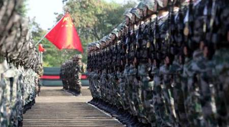 Indian and Chinese Army during the parade on the fourth India China joint military training excercise Hand -in-Hand  at Aundh military station on it's concluding day on Tuesday. Express Photo by Arul Horizon, 25-11-2014, Pune