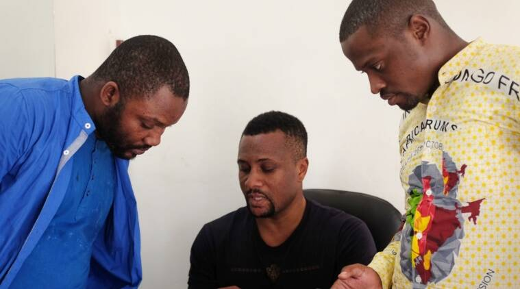 Jason (centre), one of the victims, share details about the protest against locals after four African nationals were attacked in Rajpkhurd village of Chhatarpur, South Delhi on Thursday night. The attacks triggered a major diplomatic face-off between India and Africa.Express photo by Cheena Kapoor 280516