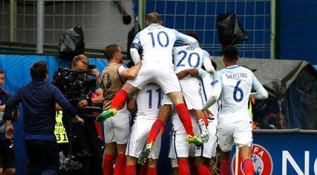 England's players celebrate after England's Daniel Sturridge scored during the Euro 2016 Group B soccer match between England and Wales at the Bollaert stadium in Lens, France, Thursday, June 16, 2016. (AP Photo/Darko Vojinovic)