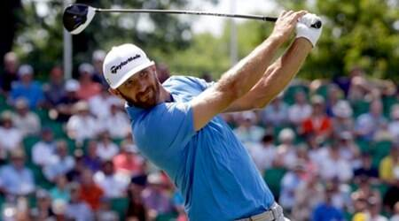 Dustin Johnson watches his tee shot  on the 10th hole during the rain delayed first round of the U.S. Open golf championship at Oakmont Country Club on Friday, June 17, 2016, in Oakmont, Pa. (AP Photo/John Minchillo)