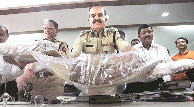 Police with the ephedrine seized from Solapur. (Source: PTI/File)