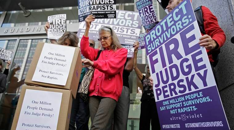 Activists from UltraViolet, a national women's advocacy organization, hold a rally before delivering over one million signatures to the California Commission on Judicial Performance calling for the removal of Judge Aaron Persky from the bench Friday, June 10, 2016, in San Francisco. A group of California lawmakers joined women's rights advocates Friday in urging a California agency to take action against the judge who sentenced a former Stanford University swimmer to six months in jail for sexually assaulting an unconscious woman. (AP Photo/Eric Risberg)