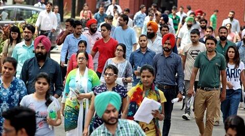 Aspirants comes out after appearing for UPSC Civil Services Examination at one of the centres in Sector 16 of Chandigarh on Sunday, August 23 2015. Express photo by Sumit Malhotra