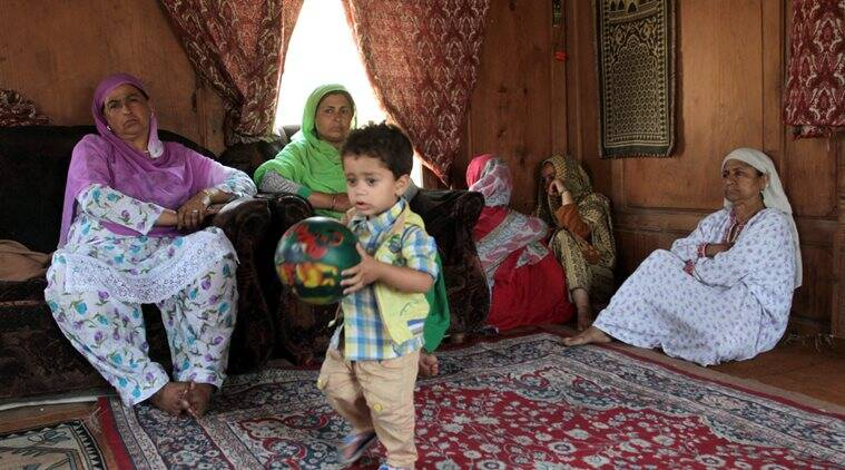 Relatives of Ghulam Muhammad Guroo mourning at his houseboat near Rajbagh. The 60-year-old boatman drowned in Jhelum river in Srinagar while saving three tourists after the Shikara they were riding capsized last week. Express Photo by Shuaib Masoodi 14-06-2016