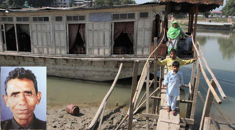Family of Ghulam Muhammad Guroo coming out of the ouseboat near Rajbagh. The 60-year-old boatman drowned in Jhelum river in Srinagar while saving three tourists after the Shikara they were riding capsized last week. Express Photo by Shuaib Masoodi 14-06-2016