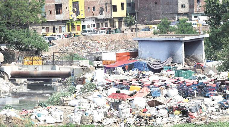 New Delhi: Polythene sacks and other wastes dumped near a residential colony in New Delhi as the world observes Environ Ment Day on Sunday. PTI Photo by Manvender Vashist    (PTI6_5_2016_00183A)