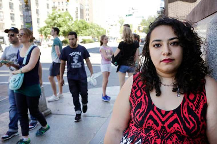 "In this Tuesday, June 14, 2016 photo, Eman Abdelhadi, a lesbian doctoral student at New York University, poses near the campus. Gay Muslims said the shooting in an Orlando nightclub sparked a complex set of emotions. They were devastated for their fellow gays and lesbians, while deeply concerned about anti-Muslim bias the shooting would generate. At the same time, they were caught at the intersection of two mutually wary groups: LGBT people who consider Islam uniquely anti-gay, and Muslims prejudiced against gays and lesbians. Abdelhadi said she feared ""Islam and queerness being pitted against each other in a sort of battle and that just making it impossible for me to exist as I am."" (AP Photo/Mark Lennihan)"