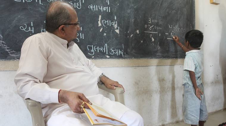 school-02 Education Minister Bhupendrasinh Chudasama evaluates students of lower and upper primary classes during the enrollment drive at Bhayla Primary School, Bavla taluka. express photo javed raja
