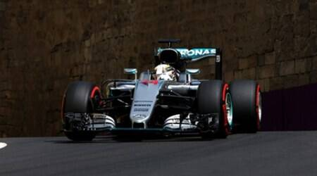 Formula One - Grand Prix of Europe - Baku, Azerbaijan - 18/6/16 - A cat crosses the track in front of Mercedes Formula One driver Lewis Hamilton of Britain as he drives during the third practice session. REUTERS/Maxim Shemetov