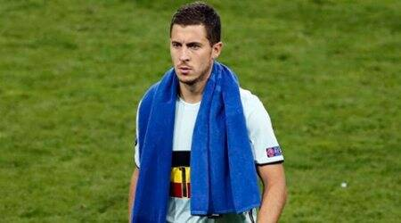 Belgium's Eden Hazard, wearing a bandage at the right leg, walks off the pitch with at the end the Euro 2016 round of 16 soccer match between Hungary and Belgium, at the Stadium municipal in Toulouse, France, Sunday, June 26, 2016. Eden Hazard scored one goal and set up another to give Belgium a 4-0 win over Hungary and a spot European Championship quarterfinals. (AP Photo/Francois Mori)