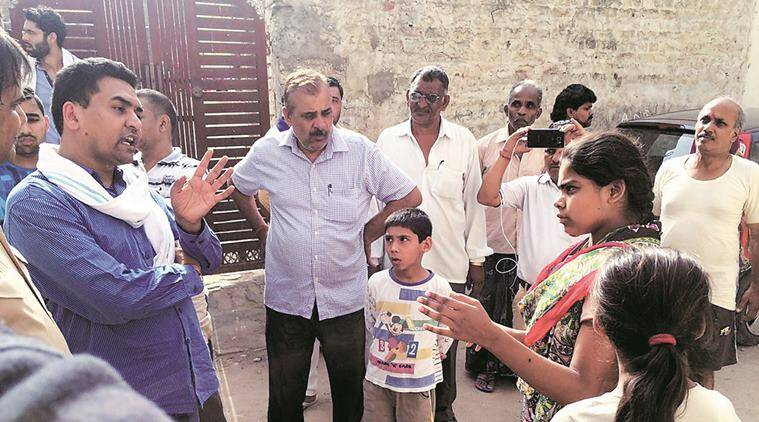 Minister Kapil Mishra (left) with the residents.  Express
