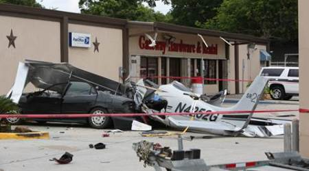 Houston: Plane crashes into car near airport, 3 dead