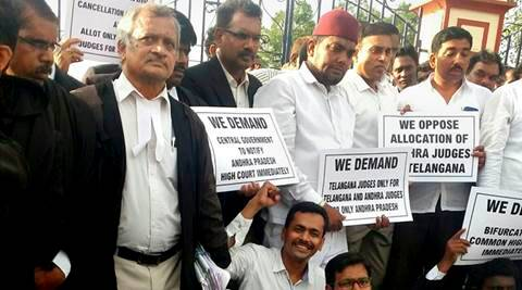 Hyderabad : Telangana advocates holding placards at a protest in front of the High Court demanding separate High Court for Telangana, in Hyderabad on Monday. PTI Photo (PTI6_27_2016_000201A)