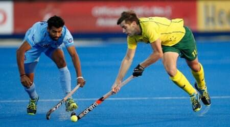 LONDON, ENGLAND - JUNE 17:  Eddie Ockenden of Australia and Devindar Walmiki of India battle for the ball during the FIH Men's Hero Hockey Champions Trophy 2016 final between Australia and India at Queen Elizabeth Olympic Park on June 17, 2016 in London, England.  (Photo by Joel Ford/Getty Images)