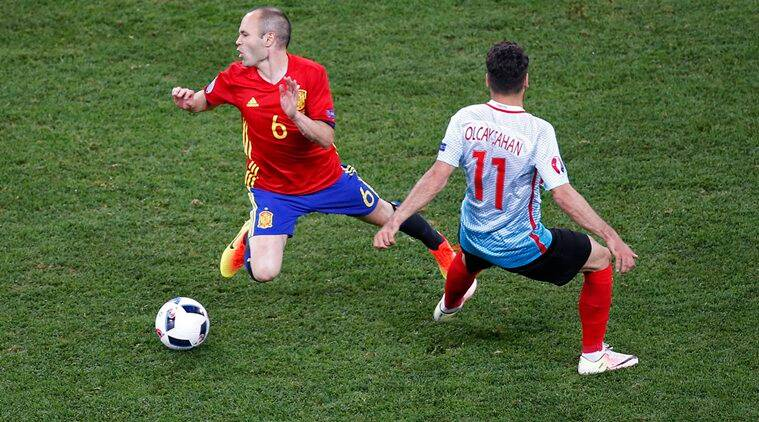 Football Soccer - Spain v Turkey - EURO 2016 - Group D - Stade de Nice, Nice, France - 17/6/16 Spain's Andres Iniesta is fouled by Turkey's Olcay Sahan REUTERS/Eric Gaillard Livepic