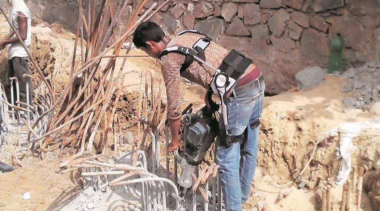 A worker uses a Jaipur Belt. (Source: Express)