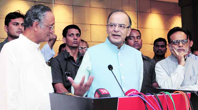 Finance Minister Arun Jaitley with West Bengal Finance Minister and Chairman of the Empowered Committee of State Finance Ministers on GST, Amit Mitra (left), and Revenue Secretary Hasmukh Adhia (right) in Kolkata on Tuesday. (Express Photo: Partha Paul)