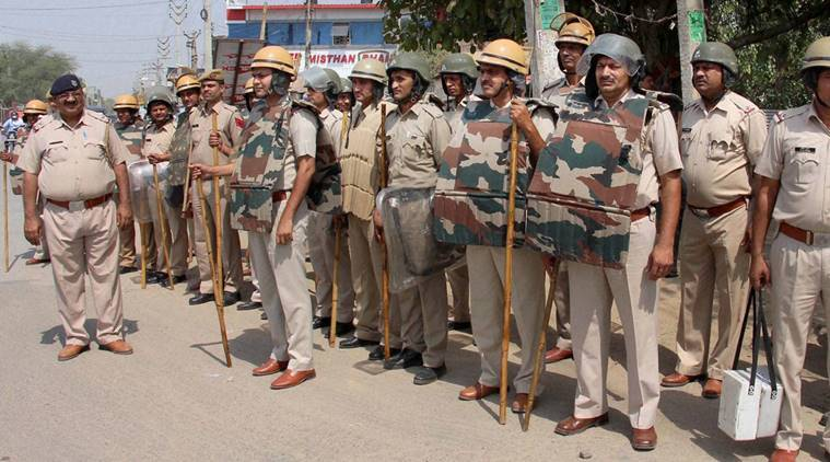 Gurgaon: Huge police force deputed for the security in Gurgaon on Monday due to jat reservation for reservation. PTI Photo (PTI6_6_2016_000172B)