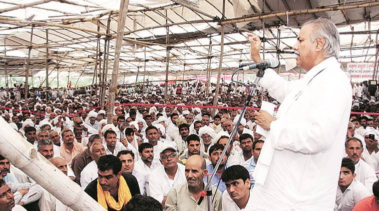 AIJASS national president Yashpal Malik urging the protesters sitting on dharna for last two weeks at Jassia village to lift dharna today in Rohtak on Sunday. June 19, 2016: Express Photo