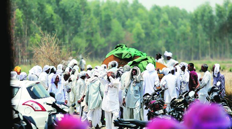 Jat protesters gather near a water tank at Jassia village near Rohtak on Sunday. Praveen Khanna