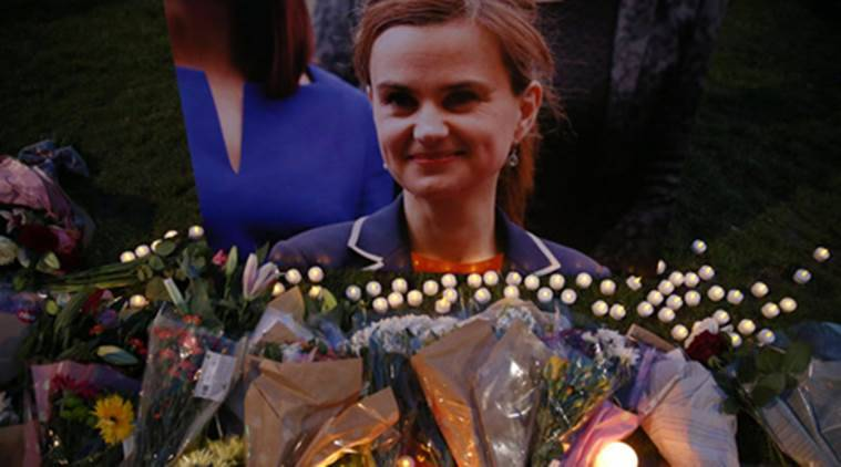 Tributes for Labour Party MP Jo Cox, who was shot dead in the street in northern England, are displayed on Parliament Square in London (Source: REUTERS)