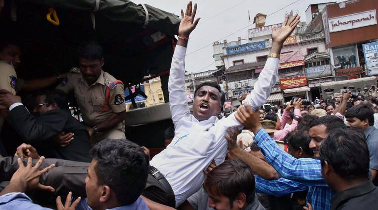 RPT...Hyderabad: Police detain the Telangana Advocates' who were protesting as a part of the 'Chalo High court' demanding bifurcation of the existing Hyderabad high court and immediate recall of provisional allocation list of judicial officers between the states of Telangana and Andhra Pradesh in Hyderabad on Monday. PTI Photo (PTI6_13_2016_000157A)