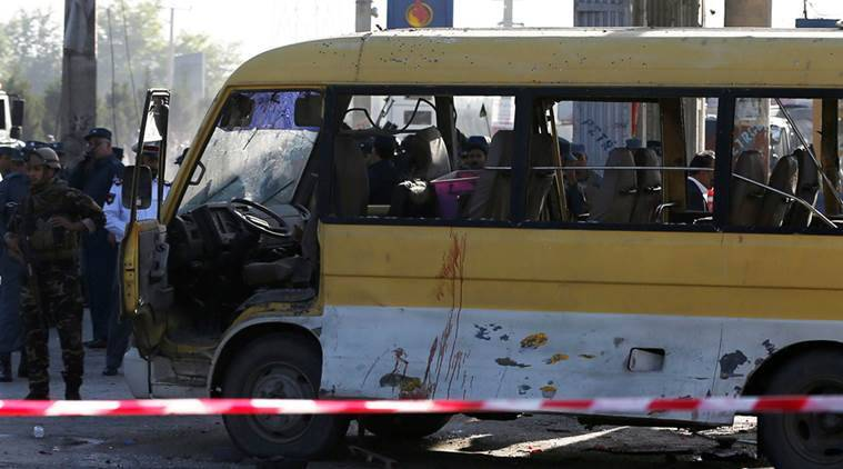 Afghan security forces inspect the damage of a minibus that was hit by a suicide attacker at the site of the incident in Kabul, Afghanistan June 20, 2016. REUTERS/Omar Sobhani
