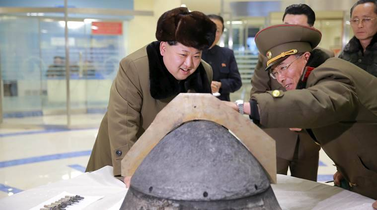 FILE PHOTO: North Korean leader Kim Jong Un looks at a rocket warhead tip after a simulated test of atmospheric re-entry of a ballistic missile, at an unidentified location in this undated photo released by North Korea's Korean Central News Agency (KCNA) in Pyongyang on March 15, 2016. REUTERS/KCNA ATTENTION EDITORS - THIS PICTURE WAS PROVIDED BY A THIRD PARTY. REUTERS IS UNABLE TO INDEPENDENTLY VERIFY THE AUTHENTICITY, CONTENT, LOCATION OR DATE OF THIS IMAGE. FOR EDITORIAL USE ONLY. NOT FOR SALE FOR MARKETING OR ADVERTISING CAMPAIGNS. THIS PICTURE IS DISTRIBUTED EXACTLY AS RECEIVED BY REUTERS, AS A SERVICE TO CLIENTS. NO THIRD PARTY SALES. SOUTH KOREA OUT. NO COMMERCIAL OR EDITORIAL SALES IN SOUTH KOREA TPX IMAGES OF THE DAY