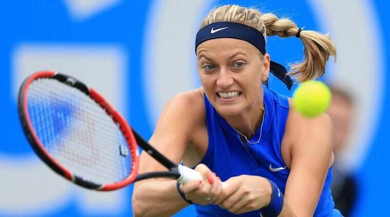 Birmingham : Czech Republic's Petra Kvitova plays a return fellow countrywoman Lucie Safarova during day two of the Birmingham Classic women's tennis tournament at the Edgbaston Priory, Birmingham. central England Tuesday June 14, 2016. AP/PTI(AP6_14_2016_000175B)