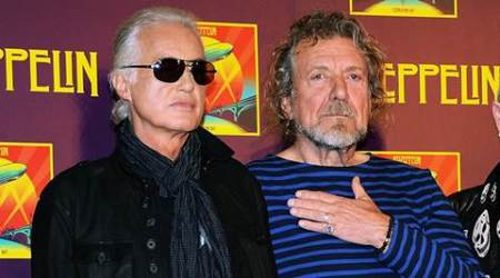 "FILE - In this Oct. 9, 2012 file photo, Led Zeppelin guitarist Jimmy Page, left, and singer Robert Plant appear at a press conference ahead of the worldwide theatrical release of ""Celebration Day,"" a concert film of their 2007 London O2 arena reunion show, in New York. Led Zeppelin's lawyers asked a judge Monday, June 20, 2016, to throw out a case accusing the band's songwriters of ripping off a riff for ""Stairway to Heaven."" (Photo by Evan Agostini/Invision/AP, File)"