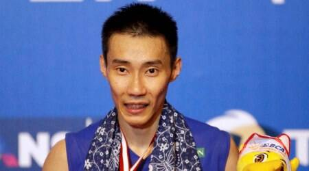 Jakarta : Malaysia's Lee Chong Wei shows his medal as he poses for photographers after defeating Denmark's Jan O Jorgensen in their men's singles final match at the Indonesia Open badminton tournament at Istora Stadium in Jakarta, Indonesia, Sunday, June 5, 2016. AP/PTI(AP6_5_2016_000119B)