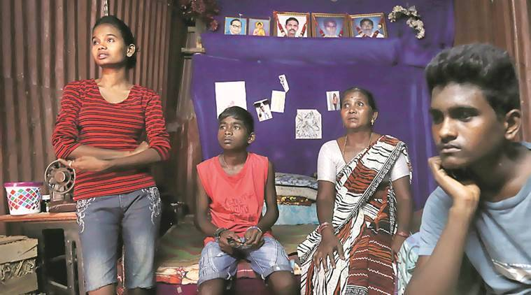 Subhangi Kamble along with her three kids Arti , Nikhil , Nitehs at their residence . Her husband died during the tragedy. Express Photo by Amit Chakravarty10-06-16,Mumbai