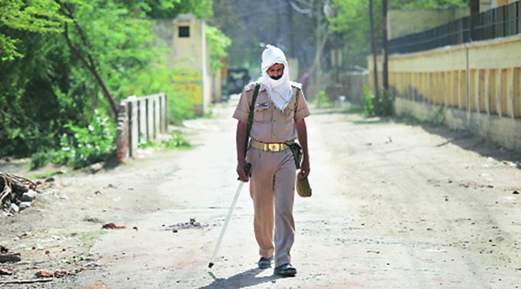 A policeman keeps vigil near the main gate of Jawahar Bagh, Mathura, on Saturday. Oinam Anand