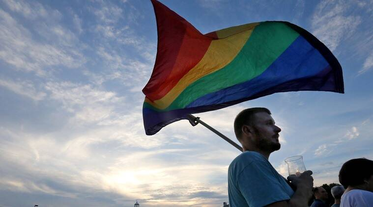Gabriel Swaidner of Gulfport holds a rainbow flag during a vigil near the lighthouse to honor the victims of the mass shooting in Orlando, Monday, June 13, 2016, in Biloxi, Miss. A gunman killed dozens of people in a massacre at a crowded gay nightclub in Orlando on Sunday, making it the deadliest mass shooting in modern U.S. history. (John Fitzhugh/The Sun Herald via AP) LOCAL TELEVISION OUT; MANDATORY CREDIT: MISSISSIPPI PRESS OUT; LOCAL TELEVISION OUT WLOX, LOCAL ONLINE OUT; GULFLIVE.COM OUT