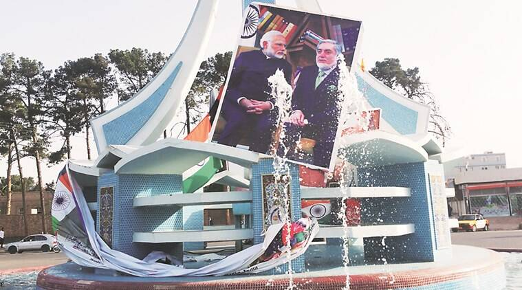 narendra modi, PM modi, modi billboards, billboards of modi and flag, modi herat visit, modi visit herat, modi herat, salma dam, modi inaugurates salma dam, herat salma dam, pm modi welcome, herat welcome modi, wapcos, indian express anchor, india news, latest news, modi news