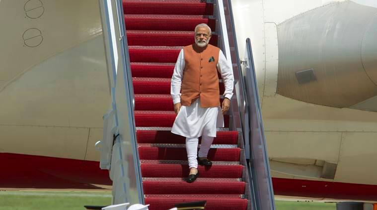 Indian Prime Minister Narendra Modi walks down the stairs from his plane upon his arrival at Andrews Air Force Base, Md., Monday, June 6, 2016. Modi in a three-day visit to Washington, will meet with President Barack Obama and will address a joint meeting of the U.S. Congress. (AP Photo/Jose Luis Magana)