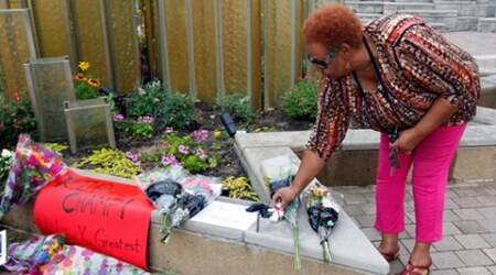A fan of the late Muhammad Ali, the former world heavyweight boxing champion, pays her respects at the Ali Center in Louisville