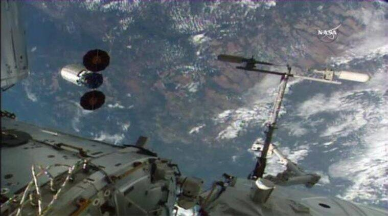 The Orbital ATK Cygnus spacecraft (L) departs the International Space Station after its release from the Canadarm2 in this still image from NASA TV taken June 14, 2016.  NASA TV/Handout via Reuters