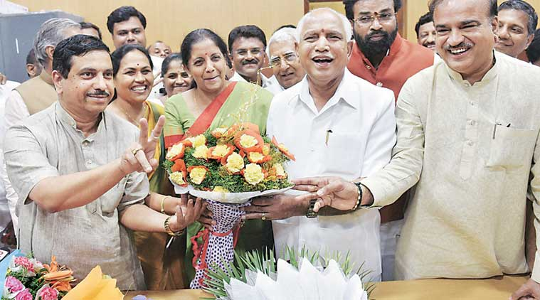 BJP state president B S Yeddyurappa with Nirmala Sitharaman. (PTI Photo)