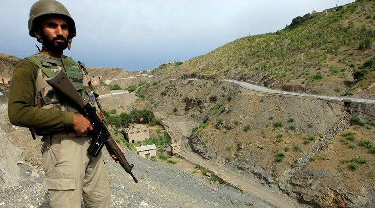 A Pakistan army soldier stands guard in the Pakistani tribal area of Khyber near the Torkham border post between Pakistan and Afghanistan, Wednesday, June 15, 2016. Renewed clashes overnight at a Pakistani-Afghan border crossing killed an Afghan border guard and wounded five, an Afghan official said Wednesday, as Islamabad dispatched more troops to the volatile boundary amid an escalation between the two neighbors. (AP Photo/Mohammad Sajjad)