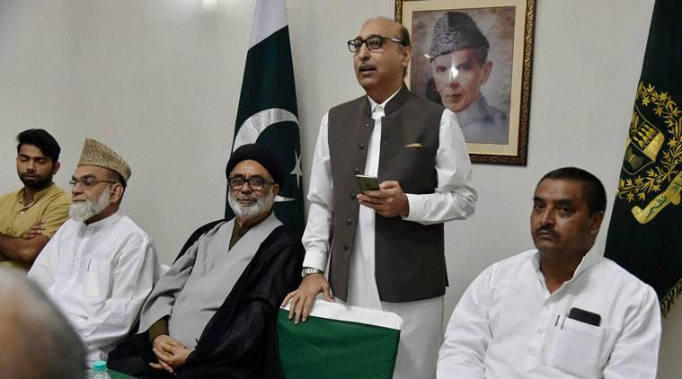 New Delhi: Pakistani High Commissioner in India Abdul Basit ,Kashmiri Muslim leader from the All Parties Hurriyat Conference Aga Syed Hassan ( 2nd L) and Samajwadi party MP Javed Ali Khan (R) during an Iftar at Pak High commission in New Delhi on Saturday .PTI Photo by Atul Yadav(PTI6_25_2016_000189B)