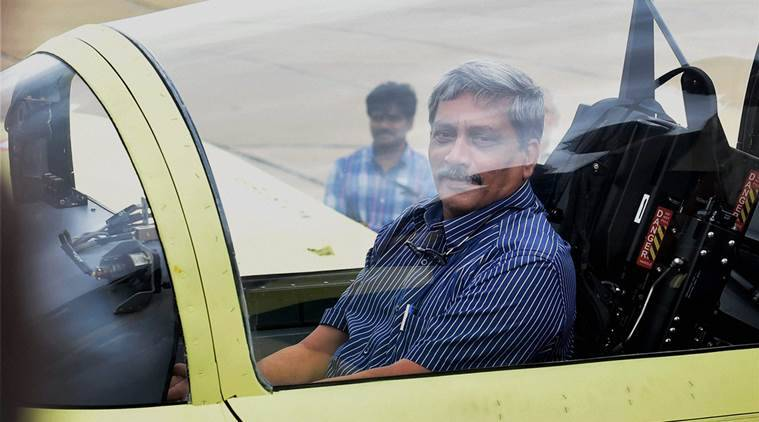 Bengaluru: Union Defence Minister Manohar Parikkar sitting inside the cockpit during the inaugural flight of the India's indigenous HTT-40 (Hindustan Turboprop Trainer), basic training aircraft at Hindustan Aeronautics Limited airport in Bengaluru on Friday. PTI Photo by Shailendra Bhojak(PTI6_17_2016_000081A)