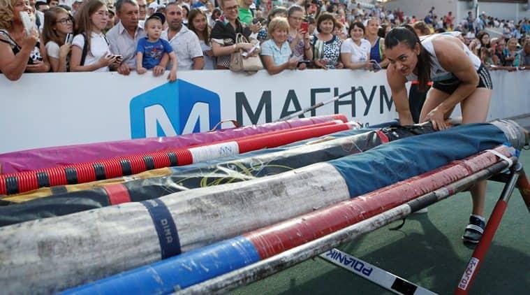 Athletics - Russian track and field championship - Women's pole vault - Cheboksary, Russia, 21/6/16. Yelena Isinbayeva packs her poles after an attempt. REUTERS/Sergei Karpukhin